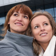 Two pretty young girls looking up — Stock Photo #4367047