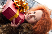 Happy young girl with a present — Stock Photo