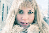 Gorgeous young blond girl in the snow — Stockfoto