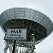 Radio telescope, radar in astronomical observatory with Stop sign. - Stock Photo