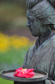 Japanese Statue Of Woman With Flower — Stock Photo