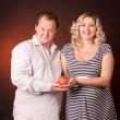 Photo of man and his pregnant wife in a studio with fruit — Stock Photo