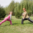 Mother and daughter engage in fitness — Stock Photo