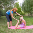Mother and daughter engage in fitness — Stock Photo #4299386