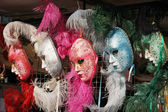 Venetian masks pink, grey, blue and green colors, decorated by f — Stock Photo