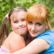 Portrait of woman with daughter — Stock Photo