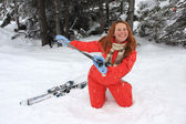 Portrait of merry young woman of skier — Stock Photo