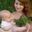 Beautiful mother with a baby — Stock Photo