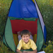Stock Photo: Happy boy in camping tent
