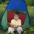 Boy in camping tent — Stock Photo
