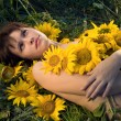 Beautiful woman and sunflowers — Stock Photo #4076781