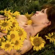 Woman and sunflowers — Stock Photo