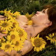 Stock Photo: Woman and sunflowers