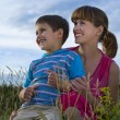 Mother with a son on to the meadow - Stock Photo