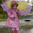 Girl with an umbrella — Stock Photo