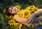 Beautiful woman and sunflowers — Stock Photo