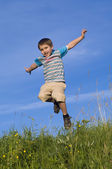 Happy boy jumping — Stok fotoğraf