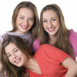 Stock Photo: Portrait of three young beautiful happy girls