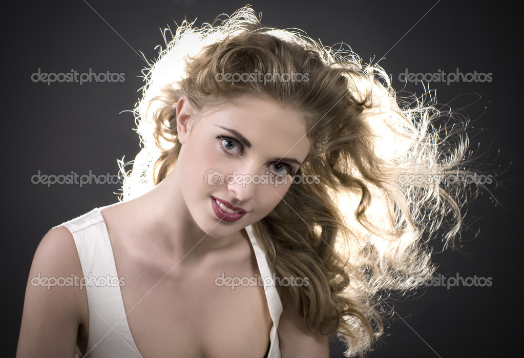 Portrait beautiful young long-haired woman  Stock Photo #4440508
