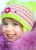 Happy little girl winter vacation — Stock Photo