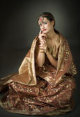 Beautiful brunette portrait with traditionl costume — Stock Photo