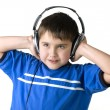 Portrait of boy in earpiecess - Stock Photo