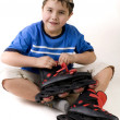 Boy and rollers — Stock Photo