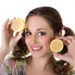 Happy girl with lemon in her hands — Foto de Stock