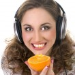 Girl listens music and eats orange — Stock Photo #4942555