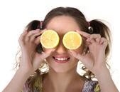 Cute girl with lemon — Stock Photo