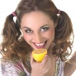 A pretty young woman eating an lemon over white background — Stock Photo