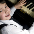 Little boy and piano. — Stock Photo #5047627