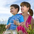 Mother with a son on to the meadow — Stock Photo