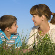 Mother with a son on the meadow — Stock Photo