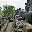 Stock Photo: Stoned image of Buddhin Borobudur