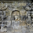 Stone carving in the Borobudur temple near Yogyakarta on Java is - Stock Photo