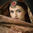 Portrait with traditionl costume. Indian style — Stock Photo #5211383