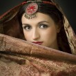 Portrait with traditionl costume. Indian style - Stock Photo