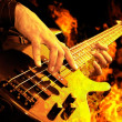 Guitar playing in fire — Stockfoto