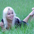 Sexy Blonde Lying in Grassy Field (6) — Stock Photo #4075400