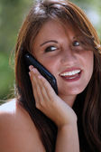 Teen Talking on Her Cell Phone Outdoors (2) — Stock Photo