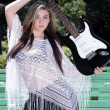 Stock Photo: Beautiful Teen Girl with Guitar (2)