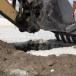 Stock Photo: Excavator Bucket Digging Hole