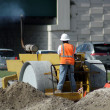 Stock Photo: Worker Operating a Compactor (2)