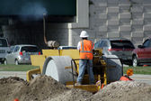 Worker Operating a Compactor (2) — Stock Photo