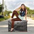 Stock Photo: Teen Girl on a Trunk in the Street (2)