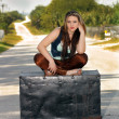 Teen Girl on a Trunk in the Street (3) — Stock Photo