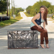 Teen Girl on a Trunk in the Street (4) — Stock Photo