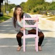 Teen Girl Sitting in a Chair in a Roadway (1) — Stock Photo