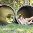 Beautiful Teen Girl in a Large Pipe — Stock Photo